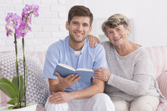Nurse and elder women on a couch Royalty Free Stock Photography