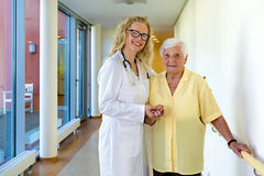 Nurse and Elderly Patient Smiling at the Camera stock photo