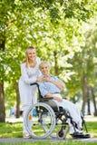 Nurse with elderly patient Royalty Free Stock Photos