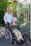 Nurse and Elderly on Wheelchair Smiling at Camera Stock Photo