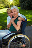 Nurse embracing disabled senior Royalty Free Stock Image