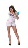 Nurse with enema point you Royalty Free Stock Images