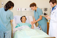 Nurse examing patients arm Stock Images