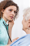 Nurse examining elderly lady Stock Photos