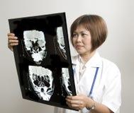 Nurse examining an X-Ray Stock Images