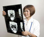 Nurse examining an X-Ray Stock Images
