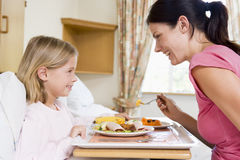 Nurse Feeding Young Girl Royalty Free Stock Image