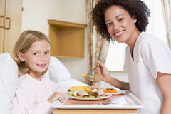 Nurse Feeding Young Girl Stock Photos