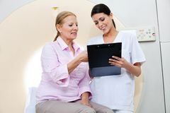 Nurse With Female Patient Stock Image