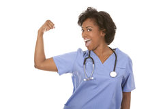 Nurse flexing muscles. Black nurse wearing scrubs on white isolated background Stock Images