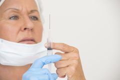 Nurse with Flu vaccination in injection Royalty Free Stock Photos