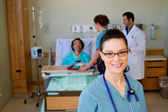 Nurse in forefront of health team Stock Photos