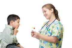 Nurse gives boy a choice of candy. Stock Images
