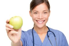 Nurse giving apple Royalty Free Stock Photography