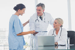 Nurse giving folder to her colleagues Stock Images