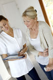 Nurse giving instructions to senior woman Royalty Free Stock Photo