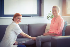 Nurse giving leg massage to woman Royalty Free Stock Images