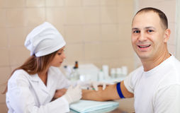 Nurse giving male patient an injection Stock Photography