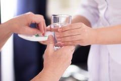 Free Nurse Giving Medication. Stock Photo - 122550590