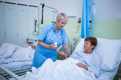 Nurse giving medication to patient Royalty Free Stock Photos