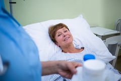 Nurse giving medication to patient Royalty Free Stock Photo