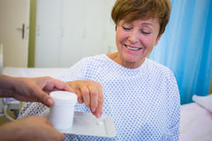 Nurse giving medication to senior patient Royalty Free Stock Photo