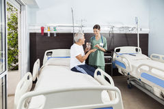 Nurse Giving Medicine And Water To Patient In Rehabilitation Cen Stock Image