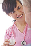 Nurse giving patient medication in hospital Royalty Free Stock Photography