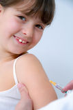 Vaccination. Nurse giving vaccination injection to little girl Royalty Free Stock Images