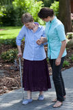 Nurse goes for a walk with the old lady Royalty Free Stock Photos