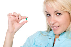 The nurse with a green capsule in a hand Royalty Free Stock Images