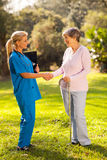 Nurse greeting patient Royalty Free Stock Photos