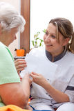 Nurse handed patient an letter Royalty Free Stock Image