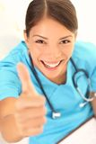 Nurse happy thumbs up smile Stock Photo
