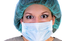 Nurse in hat and mask. A nurse in a hat and mask looing shocked stock image