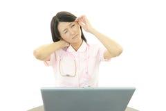 Nurse having a headache Royalty Free Stock Photography