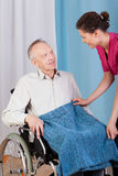Nurse helping disabled man Royalty Free Stock Images