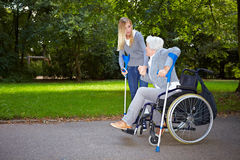 Nurse helping elderly woman Stock Images