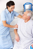 Nurse helping male patient in UK A&E royalty free stock photo