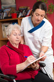 Nurse is helping a old woman Royalty Free Stock Images
