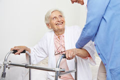 Nurse helping senior citizen Stock Photos