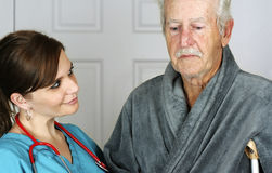 Nurse Helping a Senior on His Crutch Royalty Free Stock Images