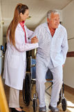 Nurse helping senior man Royalty Free Stock Photography