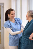 Nurse helping senior patient Royalty Free Stock Image