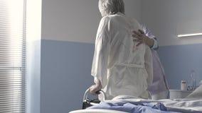 Nurse helping a senior woman at the hospital