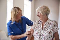 Nurse helping senior woman use a walking frame, close up royalty free stock images