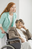 Nurse helping woman royalty free stock images