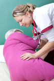 Nurse helps patient to get up Stock Images