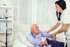 Nurse helps the patient to gets out of bed Royalty Free Stock Photo