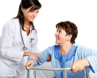 Nurse helps a senior patient to get up royalty free stock photo